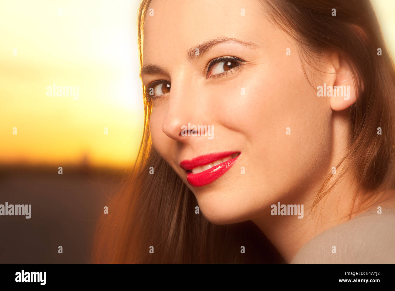 Belle, happy young woman in sunlight Photo Stock