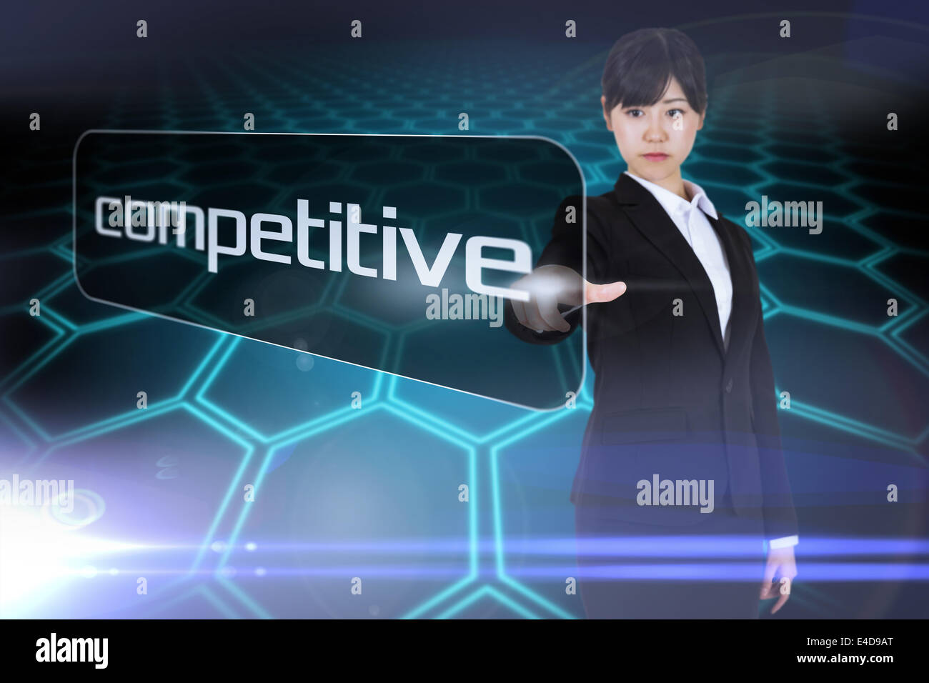 Businesswoman pointing to word compétitive Photo Stock