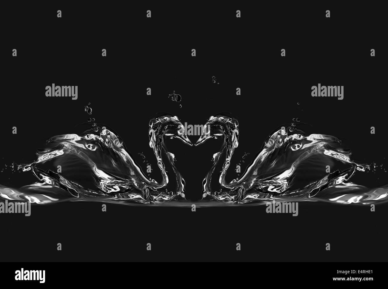 Silhouettes de deux cygnes dans l'amour de l'eau formant un cœur entre eux. Photo Stock