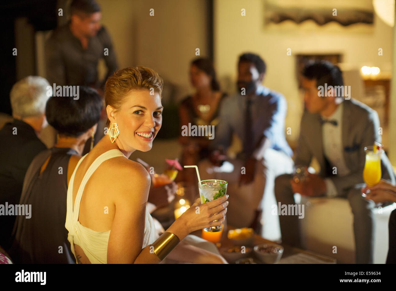 Woman smiling at party Photo Stock