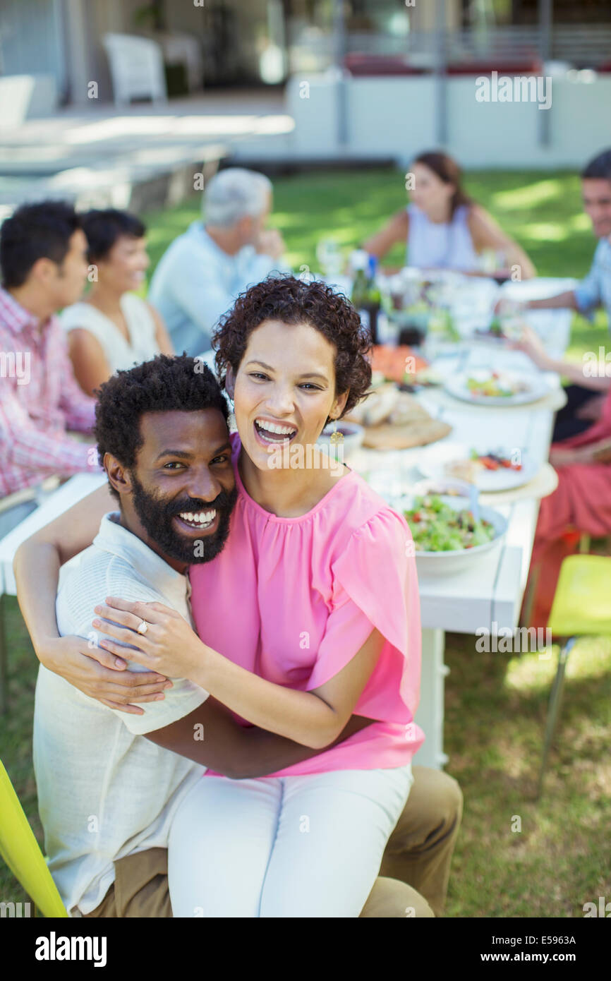 Couple hugging at table outdoors Photo Stock