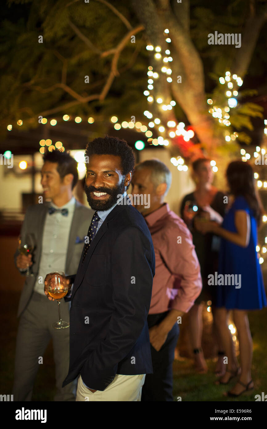 Man laughing at party Banque D'Images