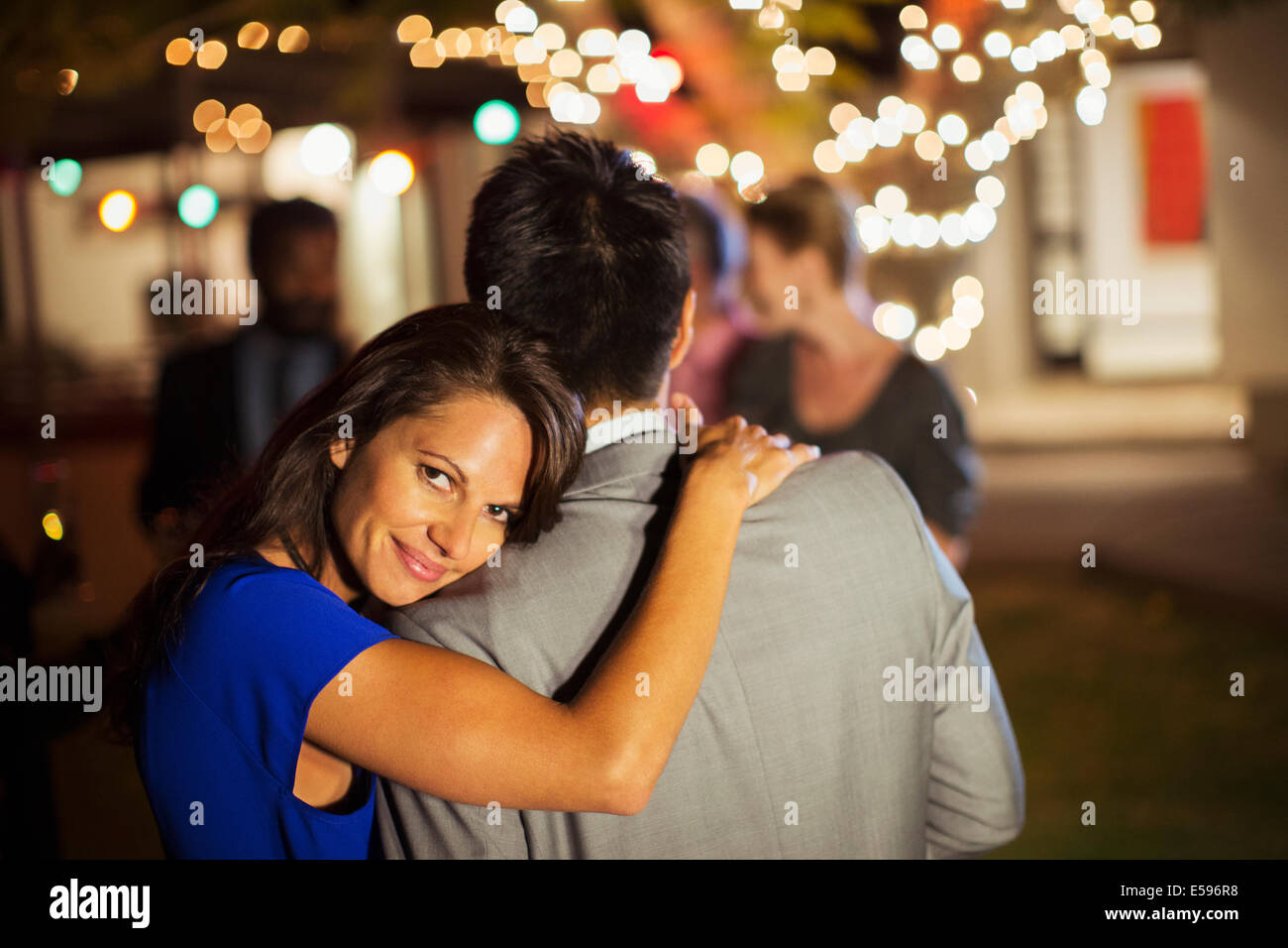 Couple hugging at party Photo Stock