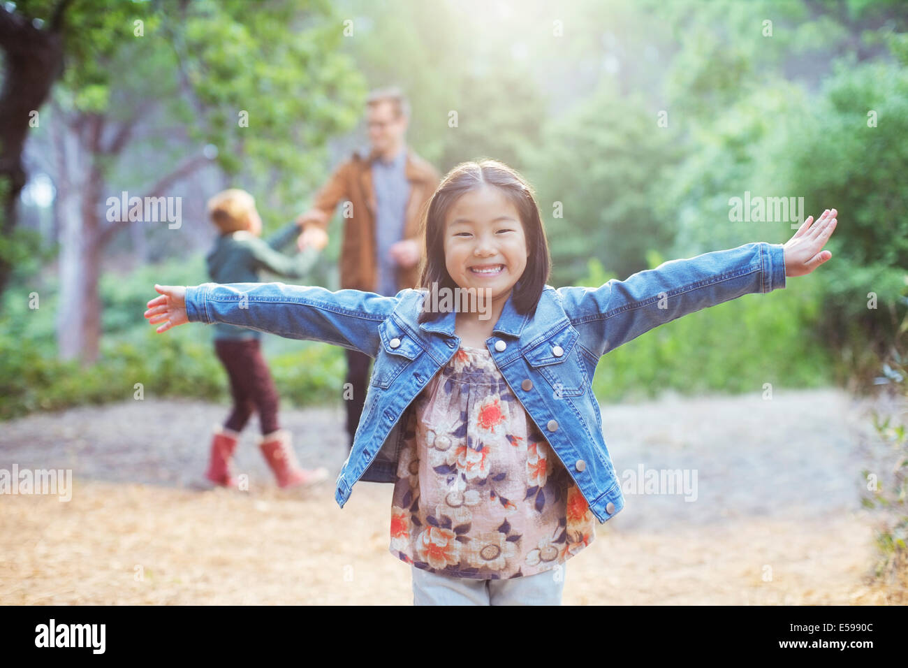 Girl cheering in forest Photo Stock