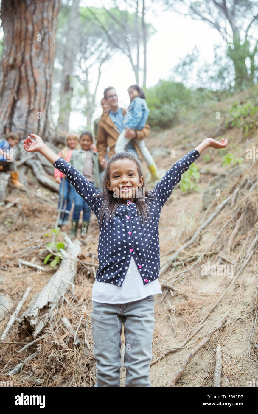 Girl holding arms out in forest Photo Stock