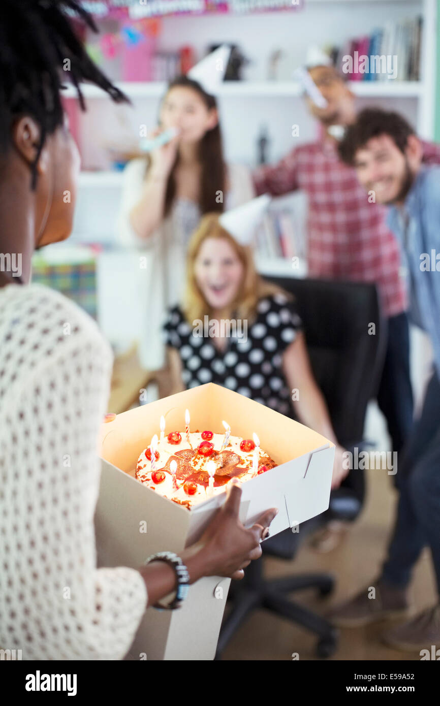 People celebrating birthday in office Photo Stock