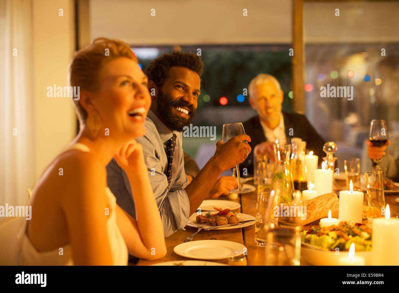 Friends laughing at dinner party Photo Stock