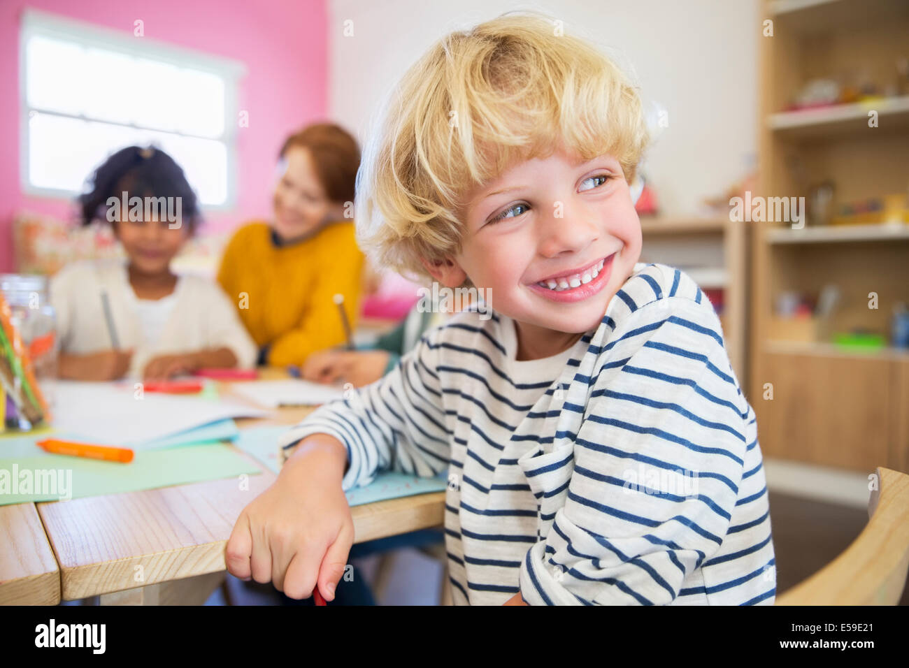Student smiling in classroom Photo Stock
