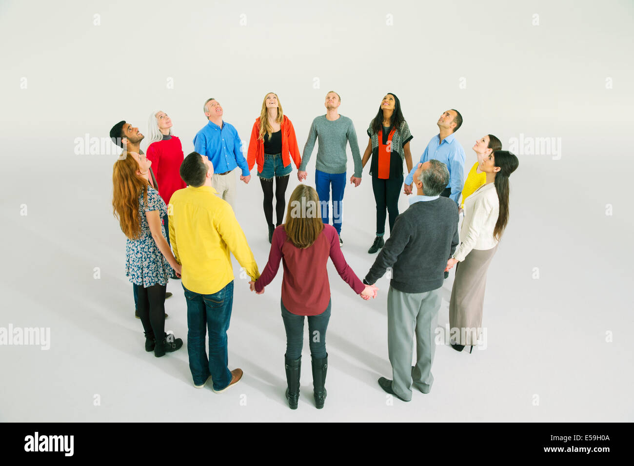 Business people holding hands in circle Photo Stock