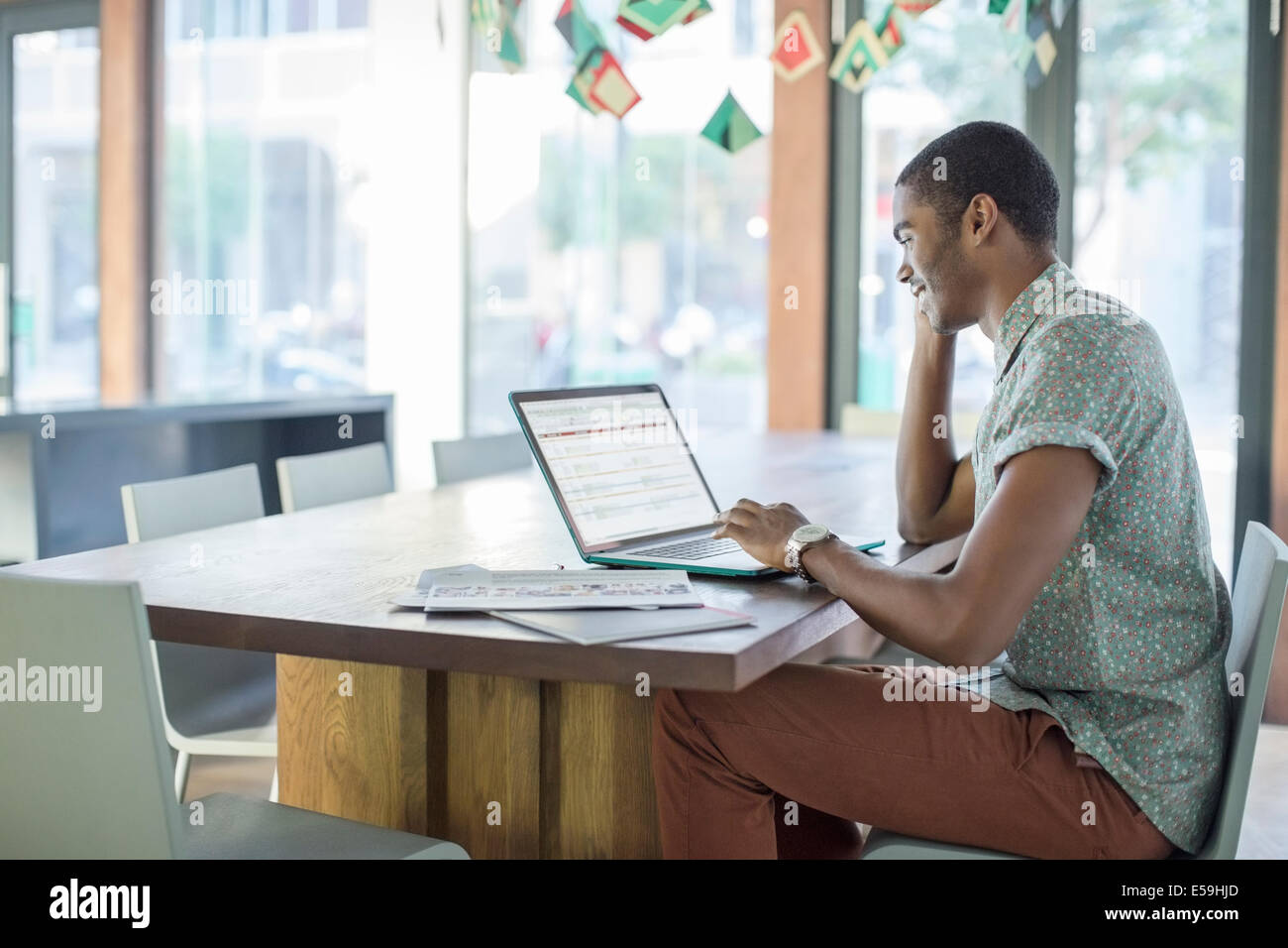 Man working on laptop in office Photo Stock