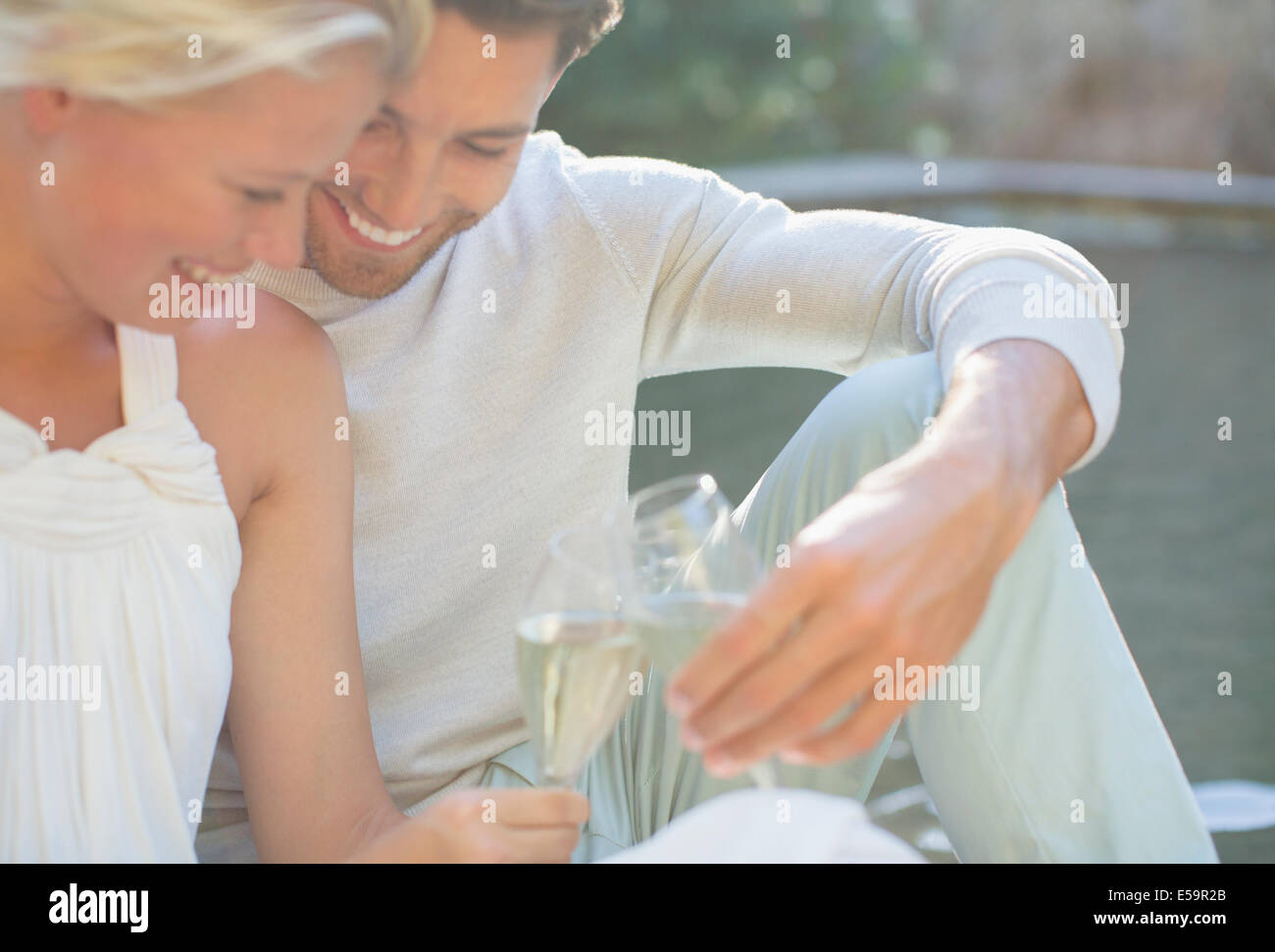 Couple toasting each other with champagne outdoors Photo Stock