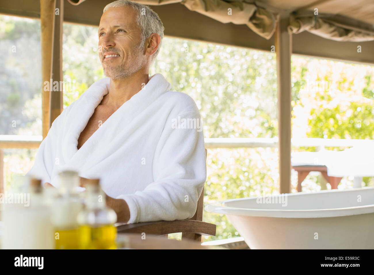 Man relaxing in spa Photo Stock