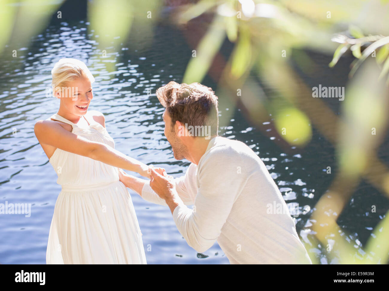 Couple playing by pool Photo Stock