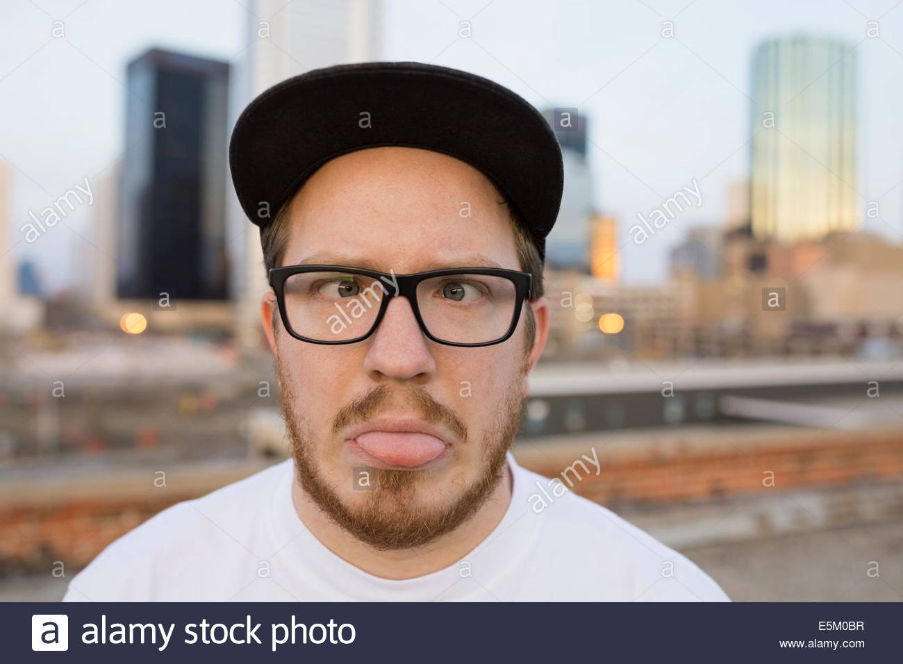 Portrait of man making a face on urban rooftop Photo Stock
