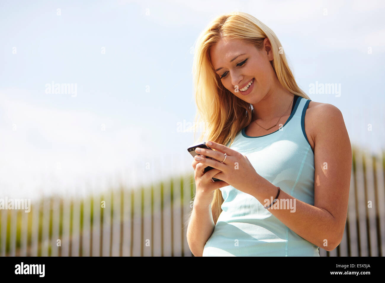Woman using smartphone Photo Stock