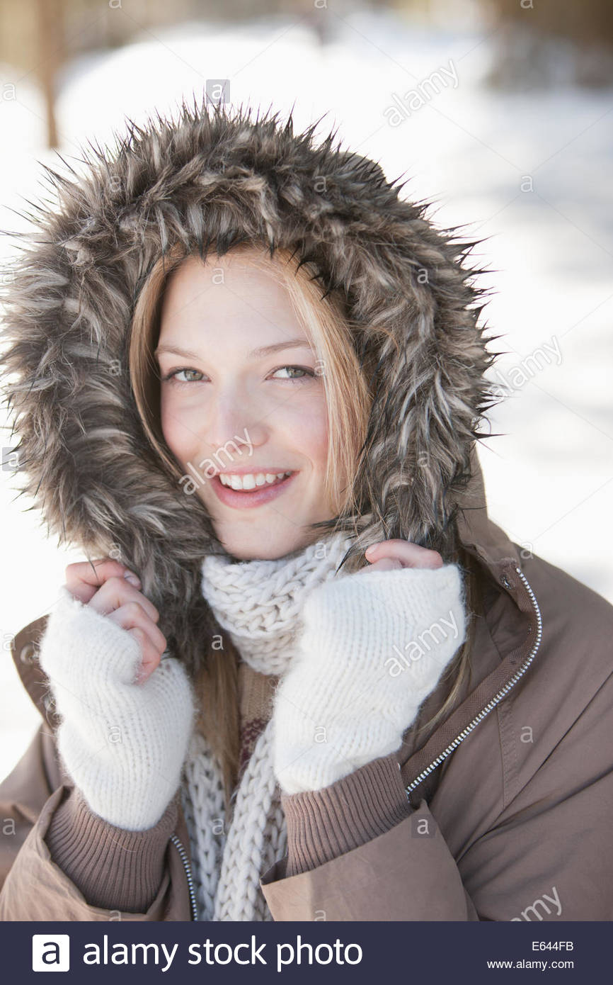 Portrait of smiling woman wearing fur hood coat Photo Stock