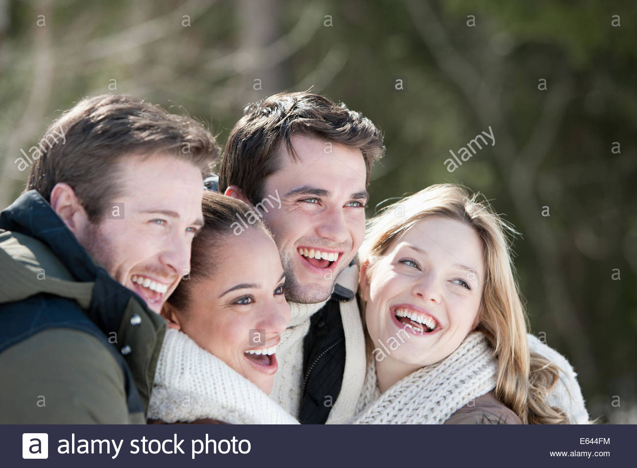 Smiling couples hugging Photo Stock