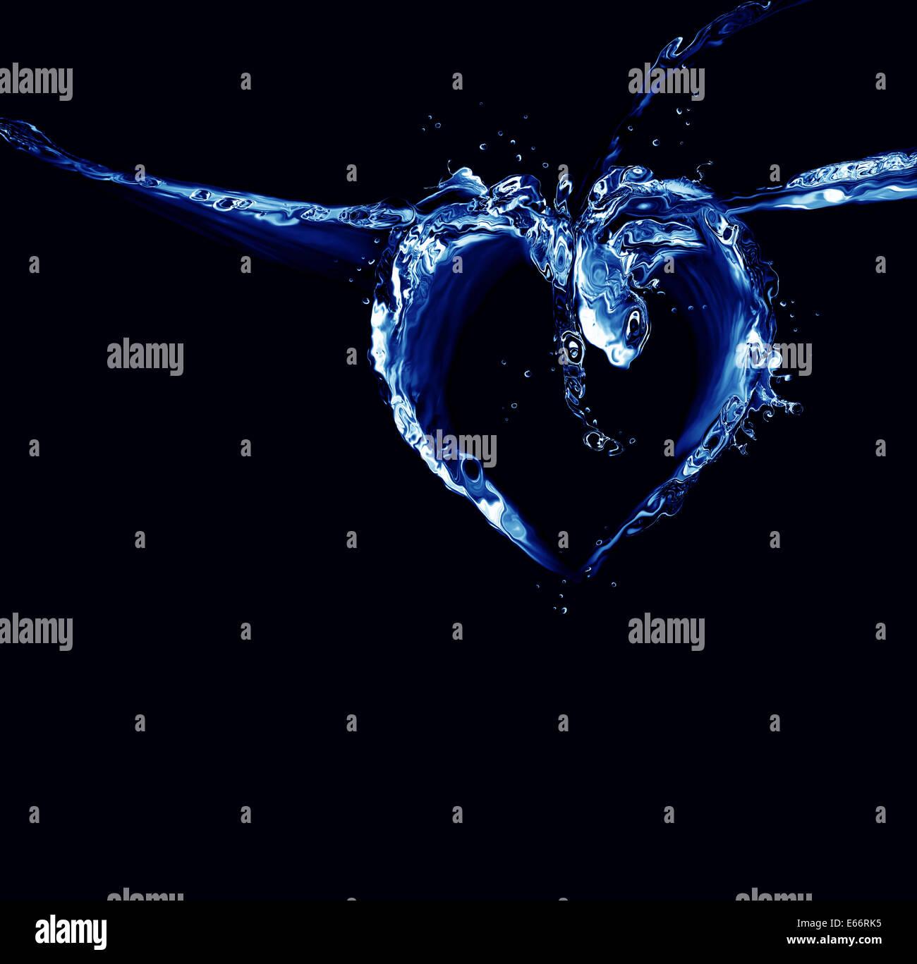 Un cœur fait de liquide bleu sur noir. Photo Stock