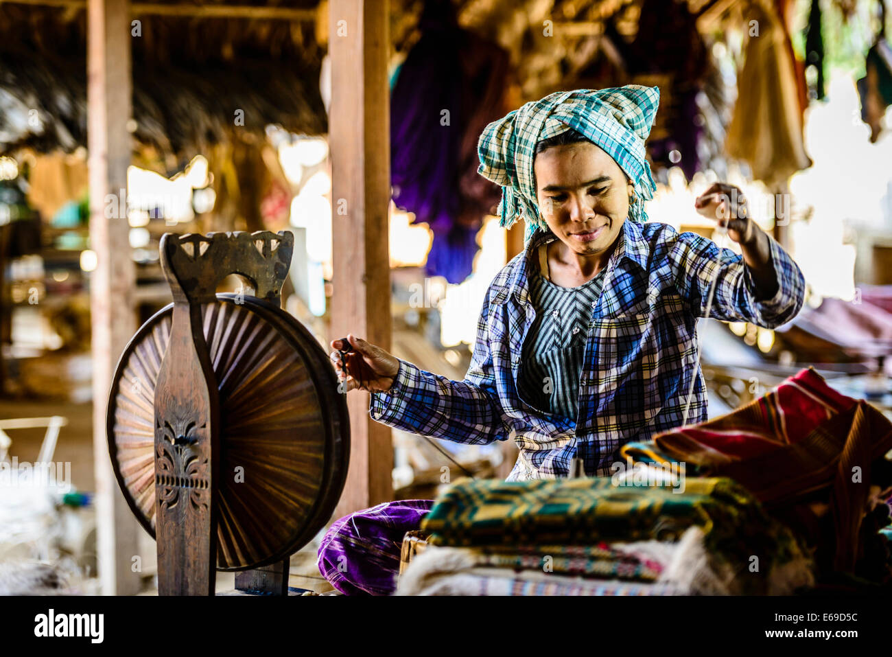 Asian woman spinning thread Photo Stock