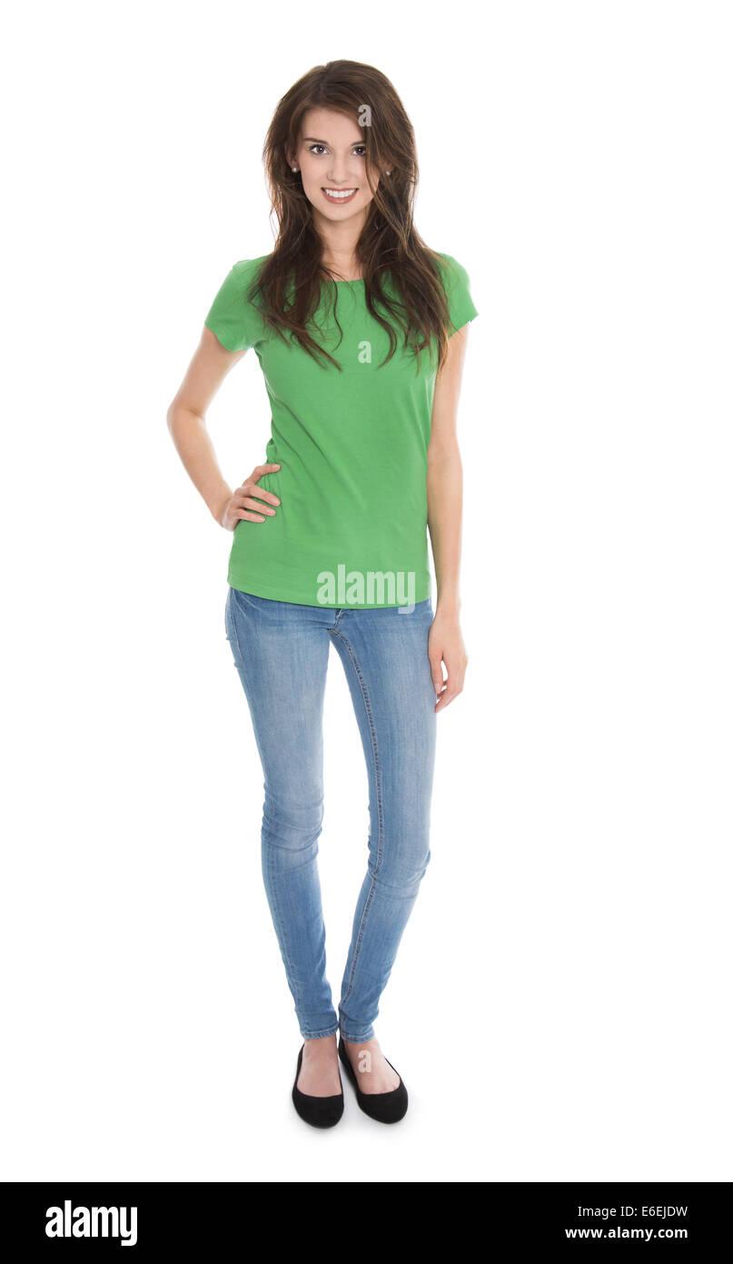 Slim isolé jeune femme en bleu et vert dans l'analyse du corps entier sur fond blanc. Photo Stock