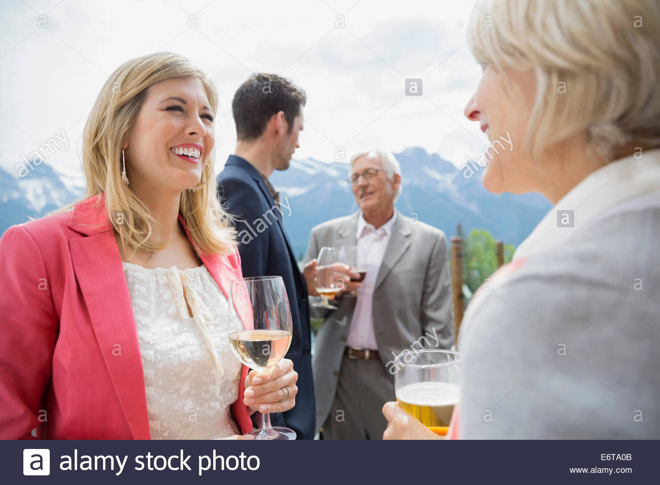 Business people talking at networking event Photo Stock