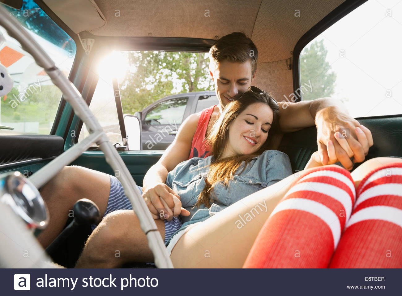 Couple relaxing together in truck Photo Stock