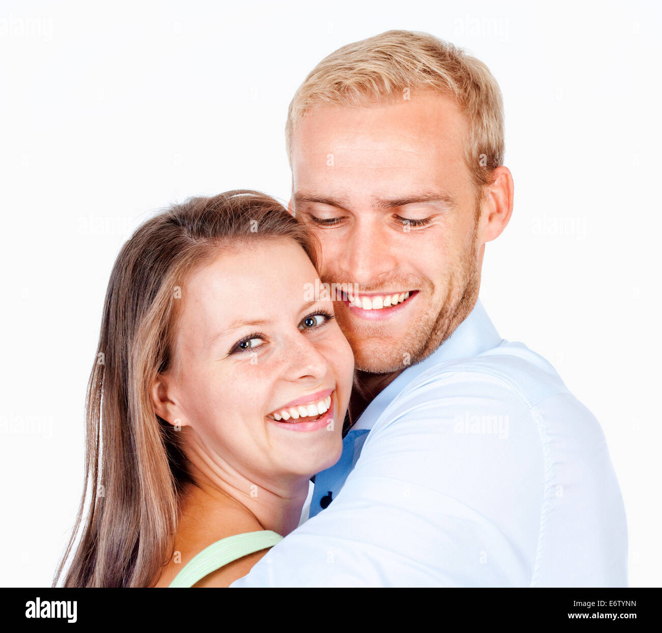Portrait of a Young Couple Smiling à - Isolated on White Banque D'Images