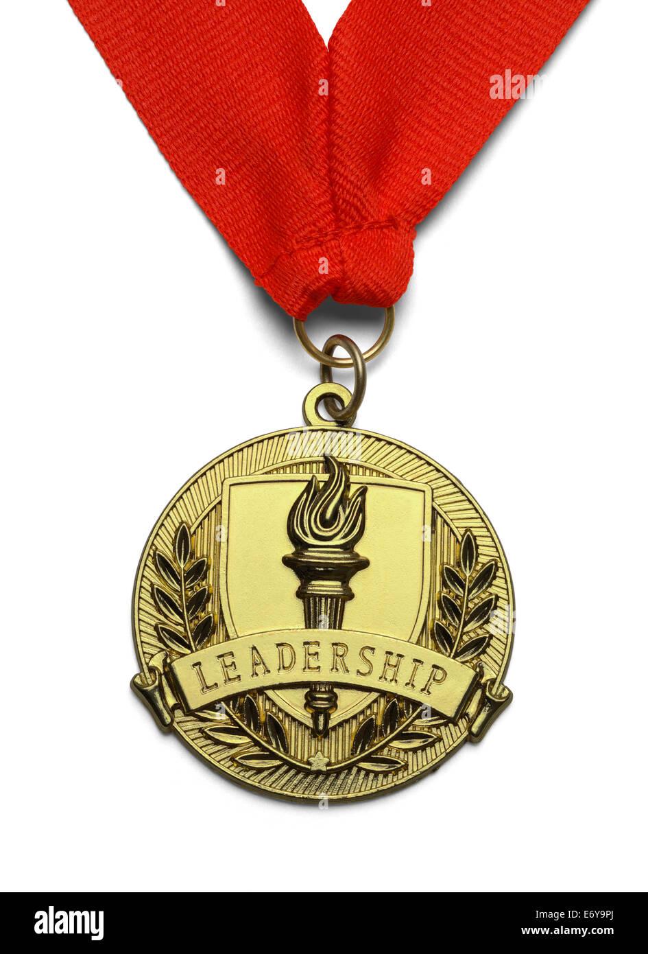 Médaille d'or avec une torche et le leadership isolé sur fond blanc. Photo Stock