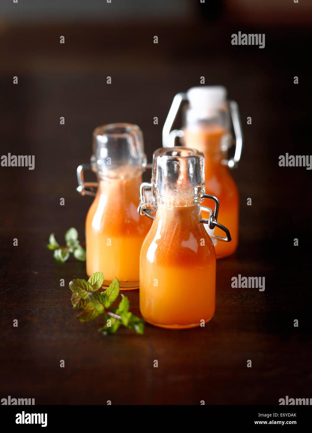 Apple, orange et jus de carotte Photo Stock