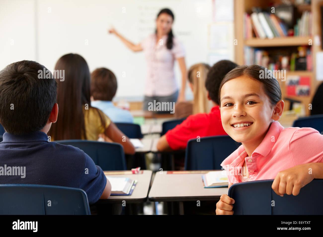 Enseignant et élèves en classe Photo Stock