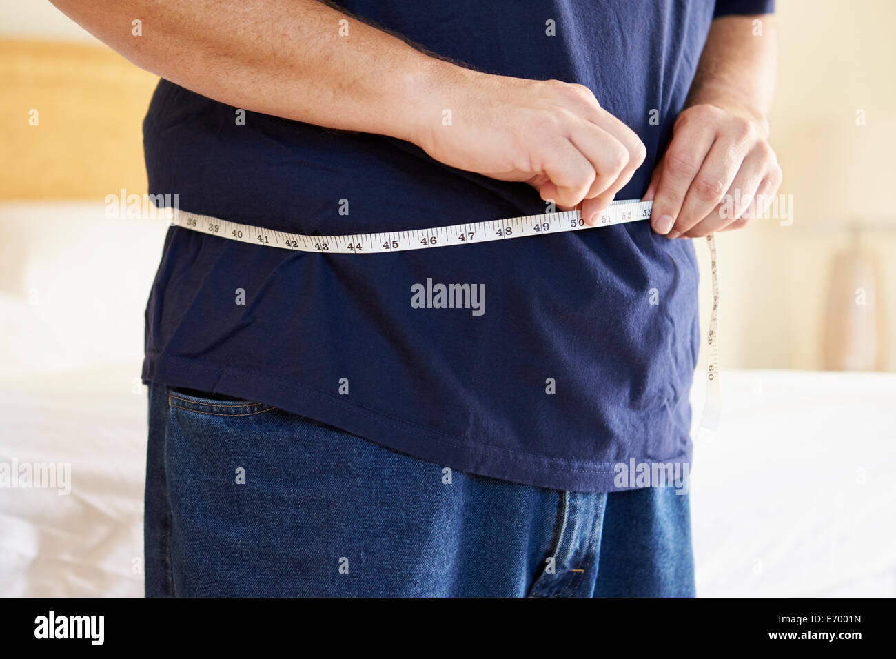 Close Up of Overweight Man Measuring Waist Photo Stock