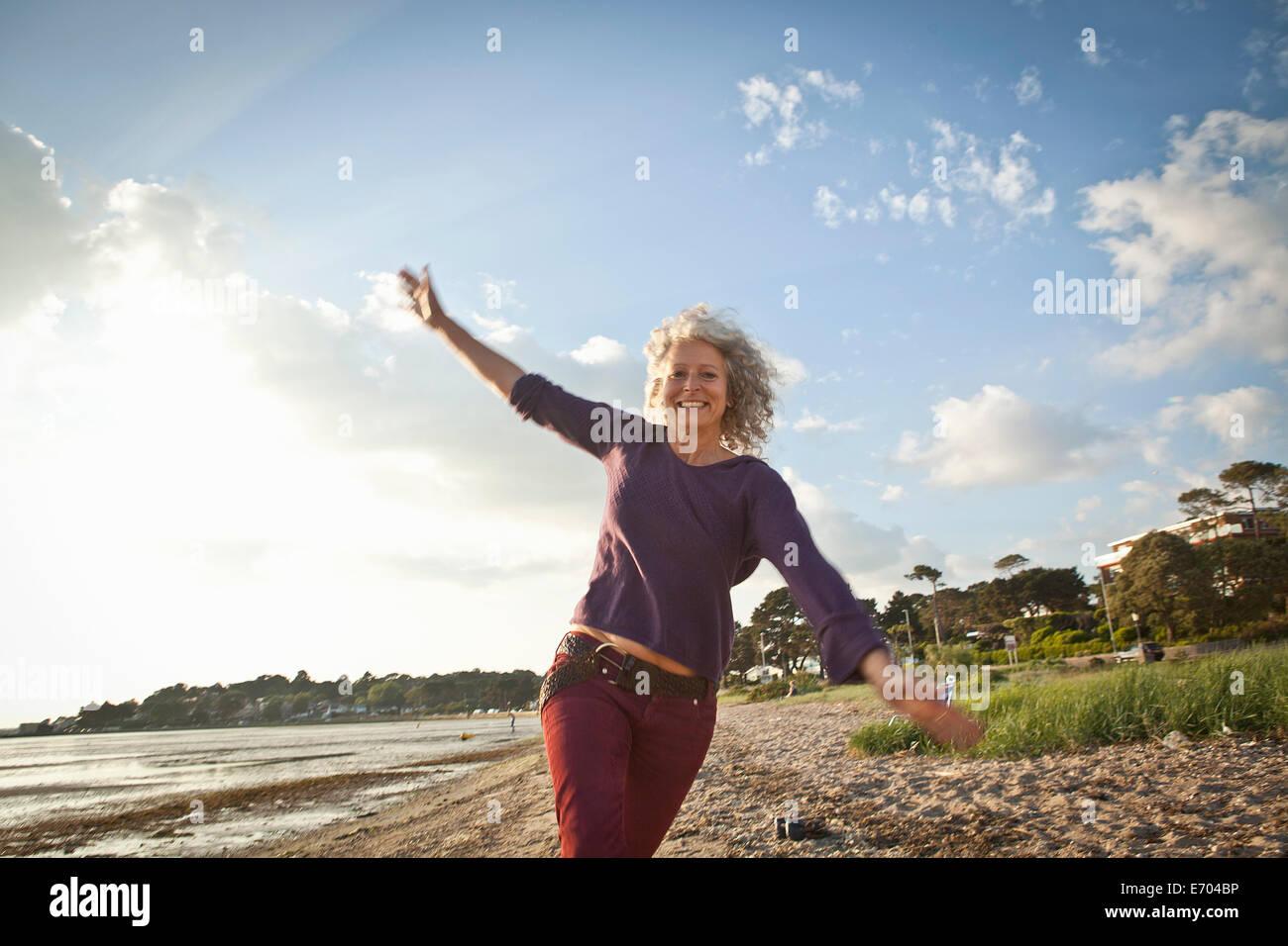Mature Woman enjoying beach Photo Stock