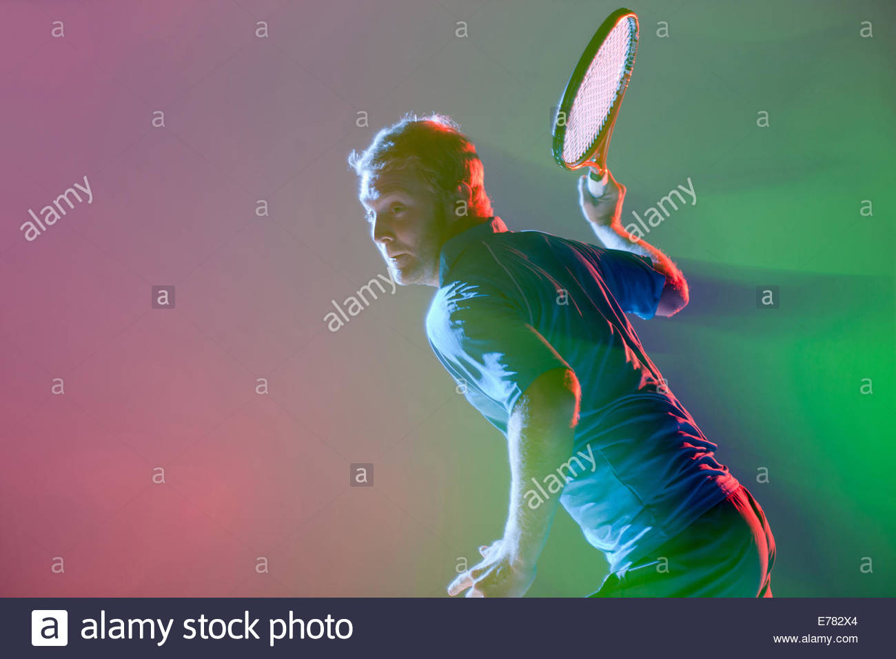 Tennis player swinging racket Photo Stock