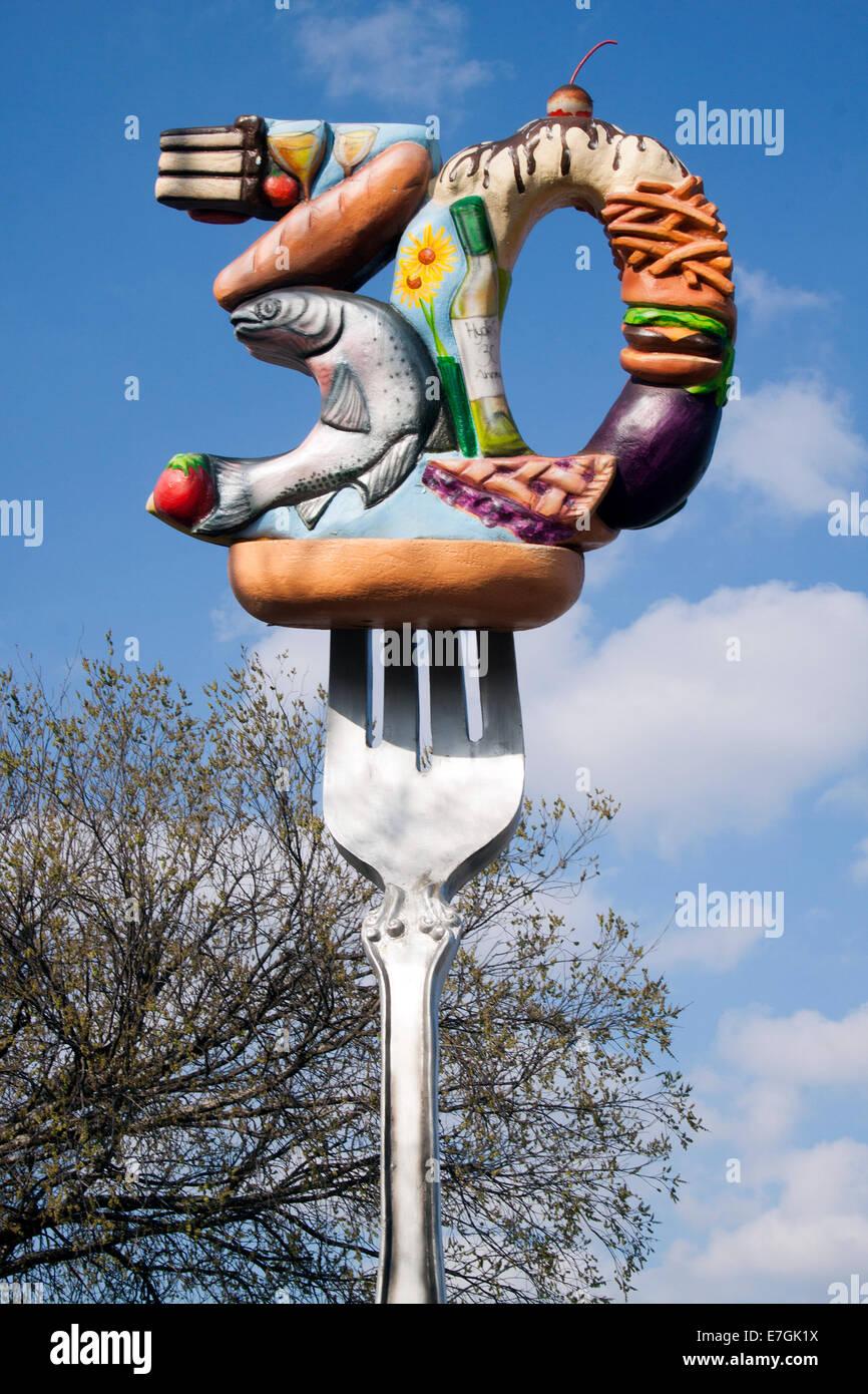 La nourriture sur une fourchette géante à l'extérieur d'un restaurant à Austin au Texas Photo Stock