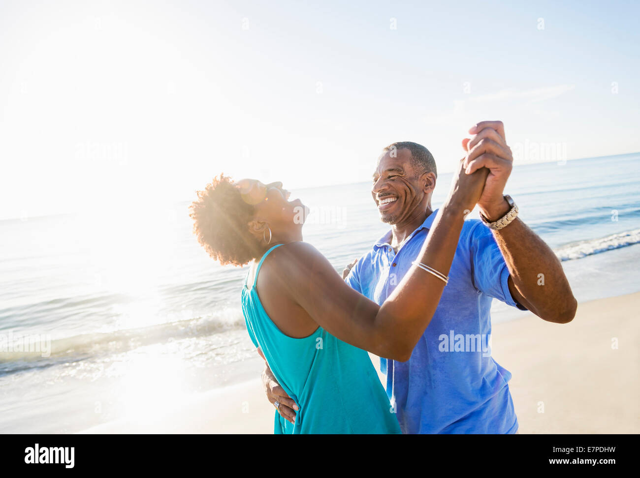 Mature couple dancing on beach Photo Stock
