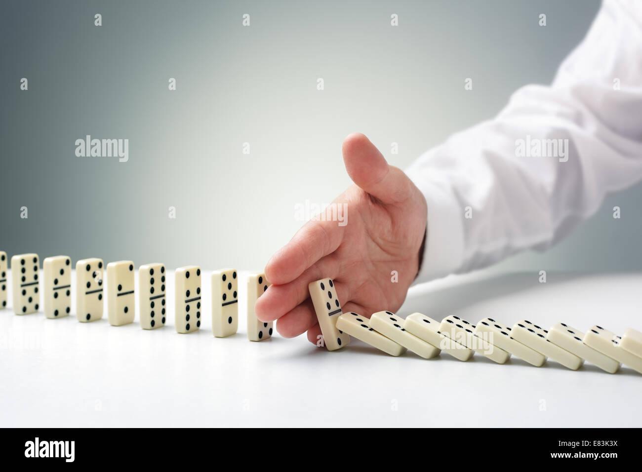 L'arrêt de l'effet domino Photo Stock
