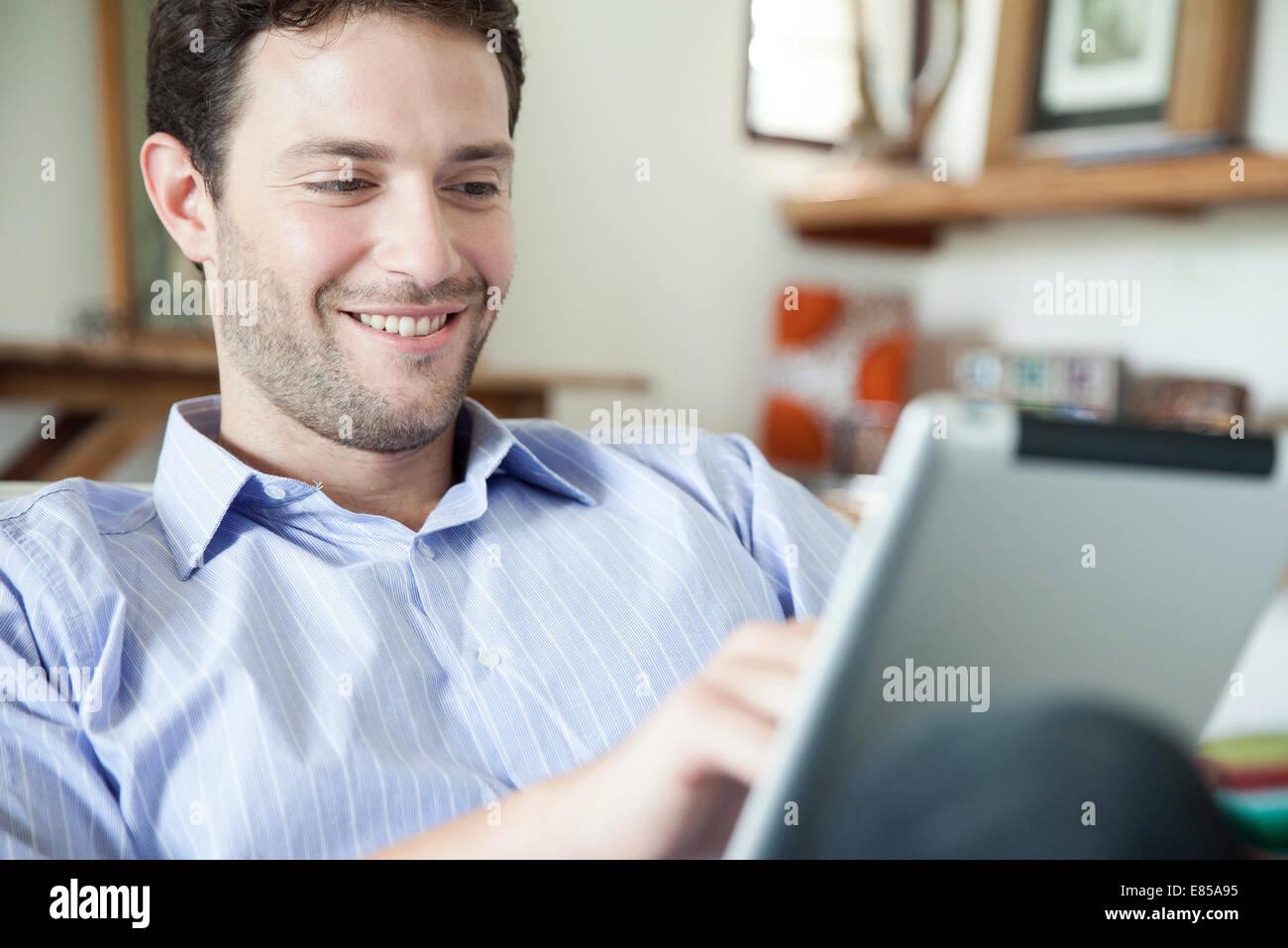 Man using digital tablet Photo Stock