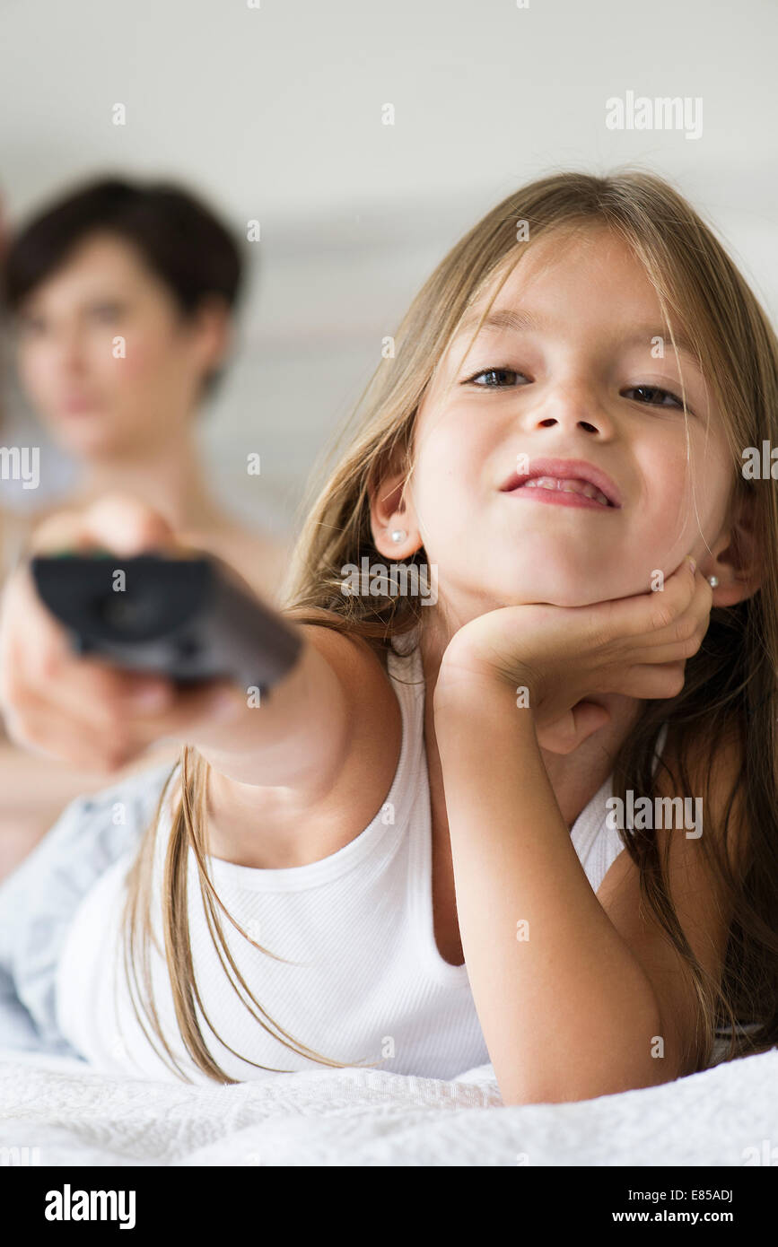 Little girl holding remote control Photo Stock