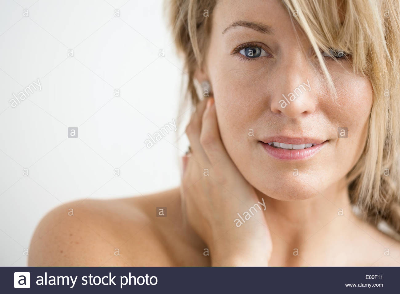 Close up of blonde woman with bare chest Photo Stock