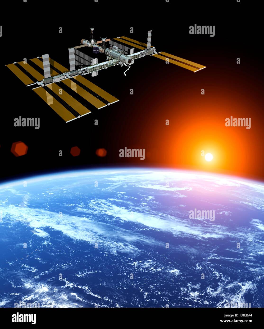 Photo de la NASA La Station spatiale internationale au-dessus de la terre flottant au coucher du soleil Photo Stock