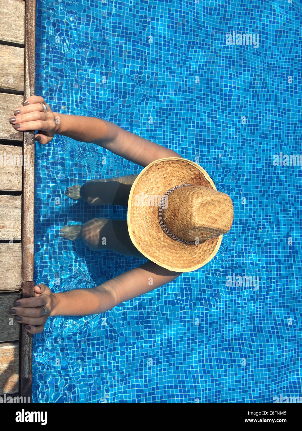 Woman exercising in swimming pool Photo Stock