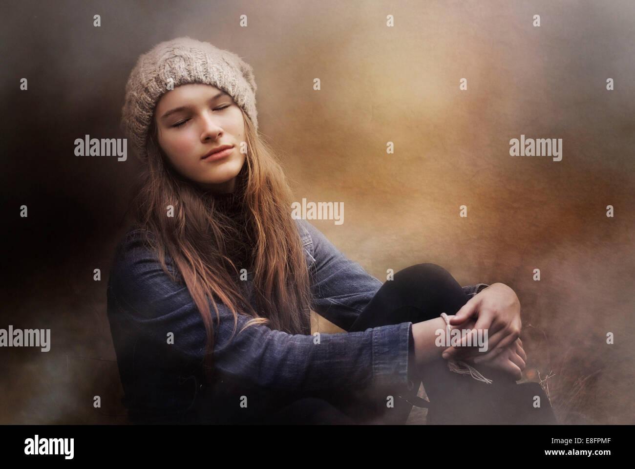 Teenage girl day dreaming Photo Stock