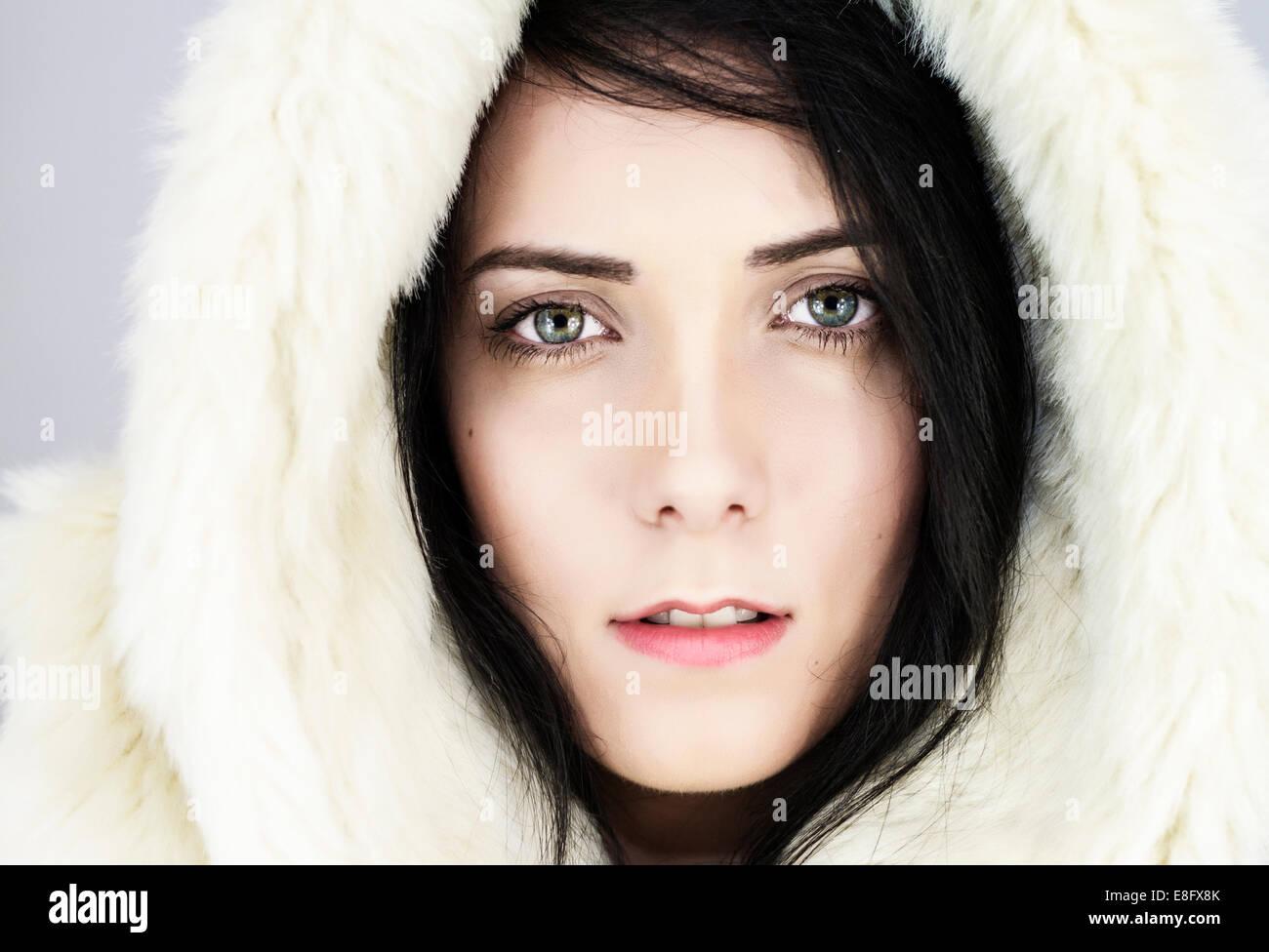 Woman with fur hood Photo Stock