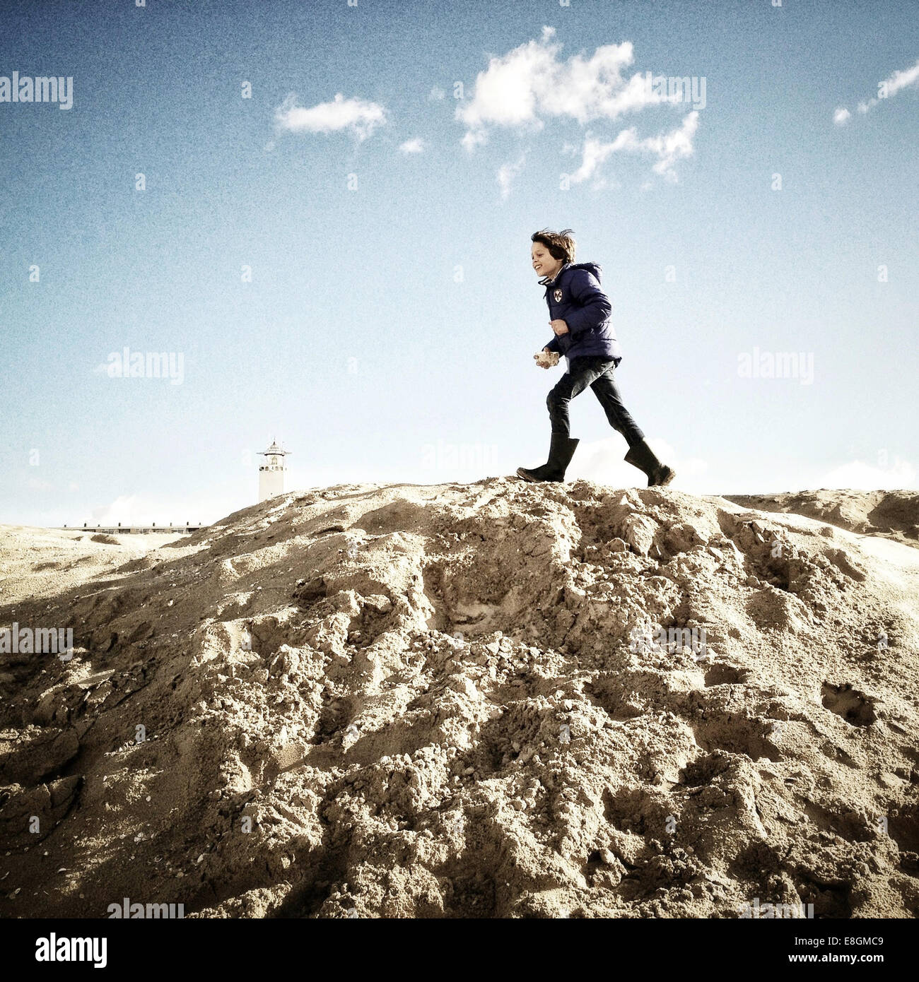 Boy running on sand dune Photo Stock