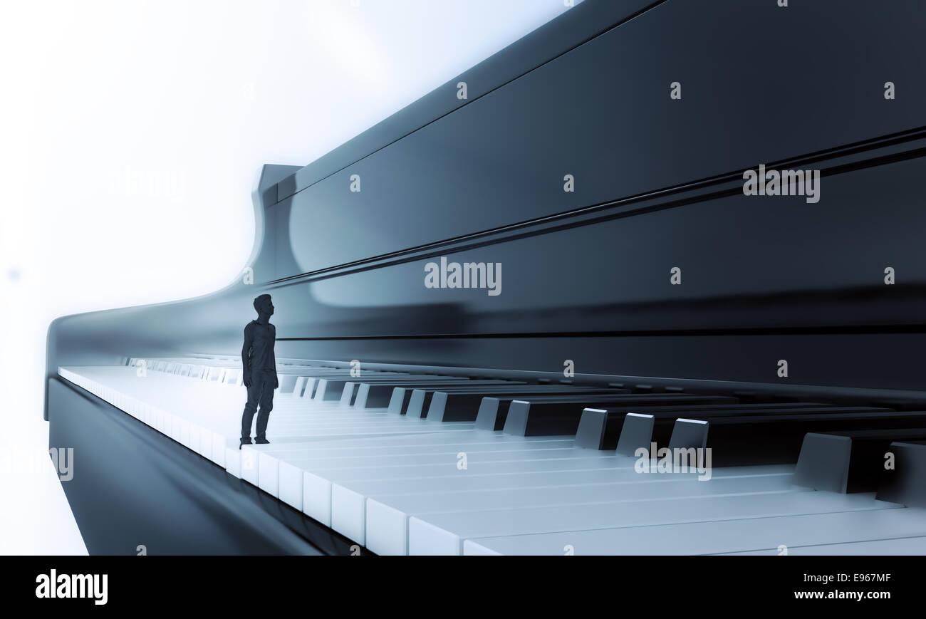 Petit homme debout sur un clavier de piano classique Photo Stock