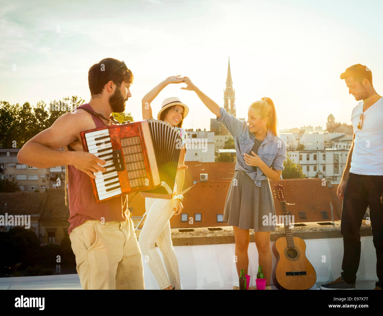 Young people having fun at rooftop party Photo Stock