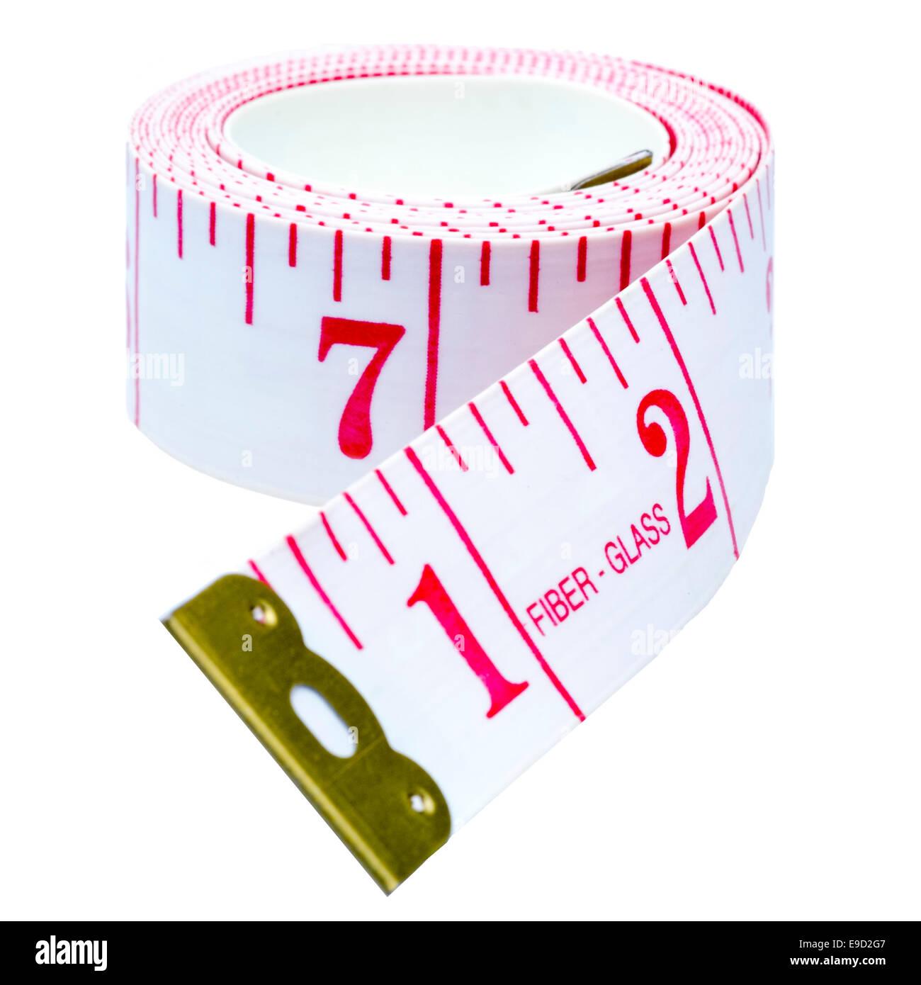 Tailleurs impériale ruban à mesurer, découper ou isolé sur un fond blanc. Banque D'Images