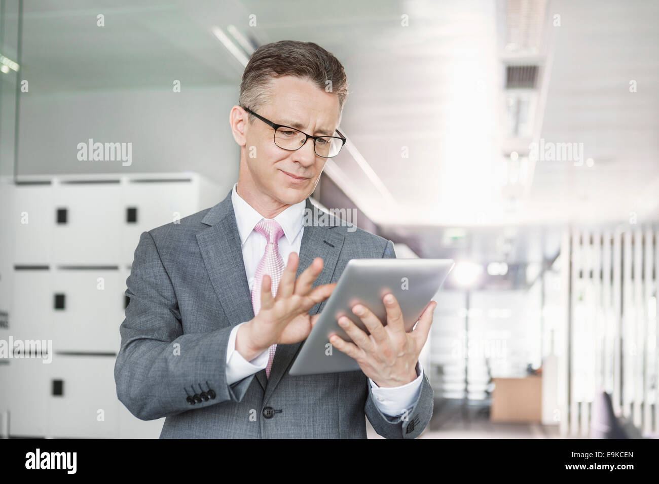 Young businesswoman using copy machine in office Photo Stock