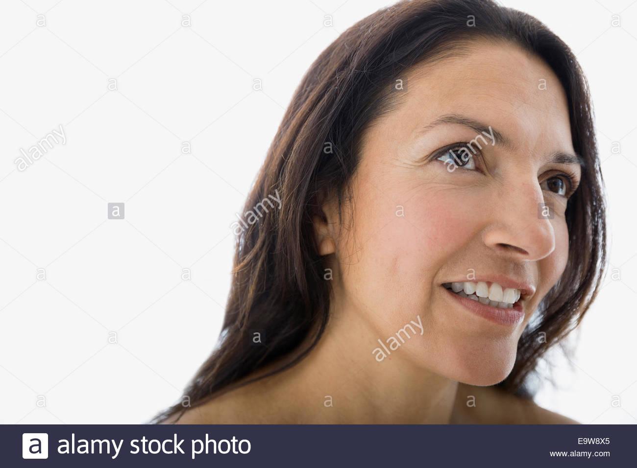 Close up portrait of smiling brunette woman Banque D'Images