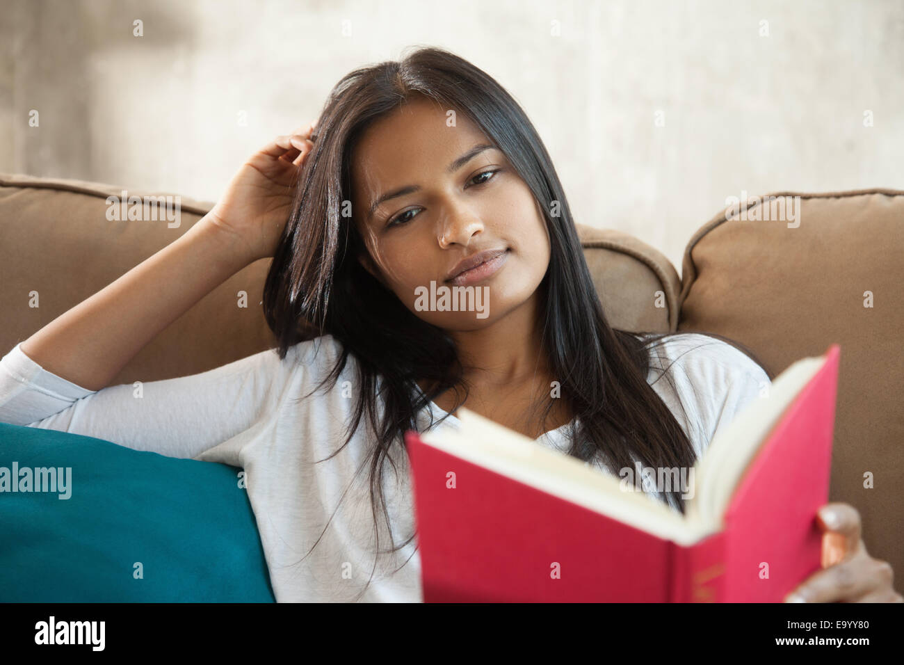 Woman Reading book at home Photo Stock
